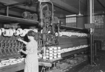 Pacific Mills. Woman does work of 4 with hand-tying machine. 1937