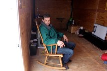 Keith Howard makes himself at home inside NH's first'Liberty Home,' a 170-square-foot cargo trailer.