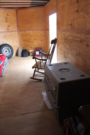 Sparse furnishings, for now., include a crate for Lucy, Keith Howard's dog.