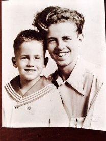 This photo was taken the day before my Uncle Frank Robidoux shipped out for his Navy service in WWII, posing here with my Dad, his only brother. My father's life would never be the same, as his only sibling, who returned after his tour of duty, would never rejoin the family household. It was a turning point for all. - Jim Robidoux