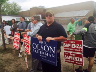 Candidate Richard Olson Jr. holds a sign outside Beech Street School on Special Election Day.