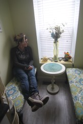 Kriss Blevens in a quiet space she created in the new salon.
