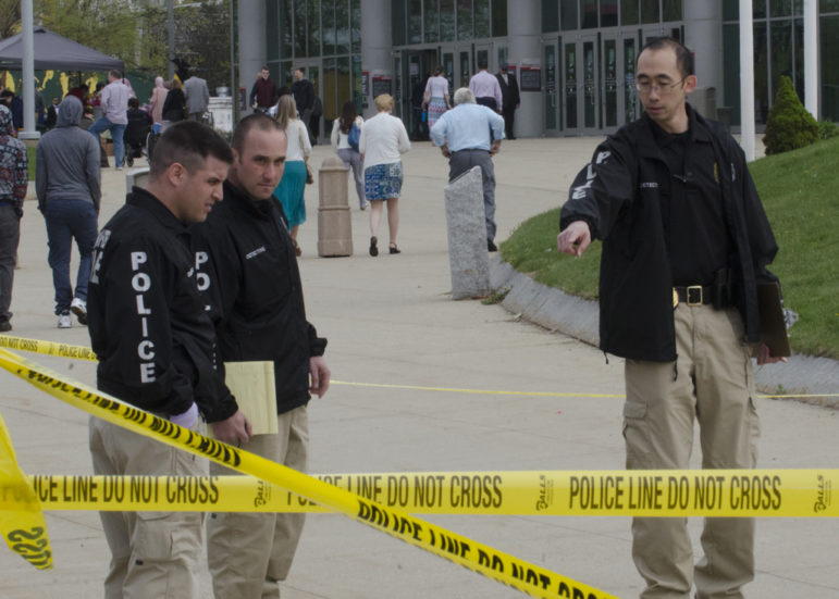 Manchester Police detectives investigate the crime scene outside of the Verizon Wireless Arena.