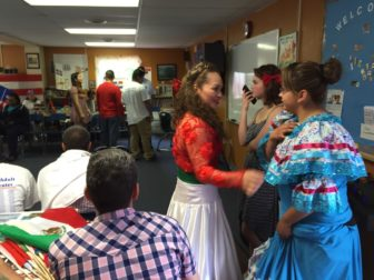 Students prepare for the annual multi-cultural celebration at the Adult Learning Center.