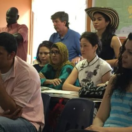 Students listen to one another talk about how the program has improved their ability to communicate, find work and be part of the community.