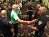 Former Mayor Robert Baines congratulates Chief Nick Willard.