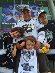 Andy Crone, of Milton Mills, with his kids, Suzanna, left, Christian, center and AJ. They were the first fans to arrive at the Verizon Wireless Center for Tuesday's Calder Cup fan celebration.