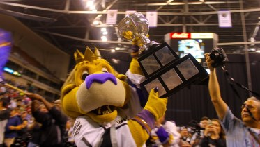 """Max, the """"best mascot in AHL,"""" with the actual Calder Cup."""