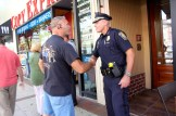 A customer shakes Chief Nick Willard's hand.