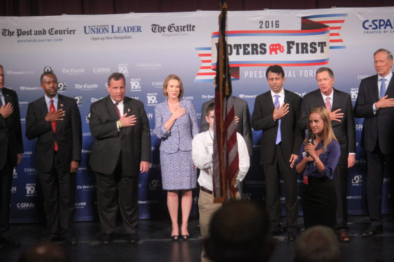 Candidates pledge allegiance at the start of the 2016 Voters First Presidential Forum.