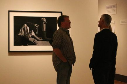 James Nachtwey chats with attendees during a preview of a collection of his photographs, on display at the Currier through Dec. 4.