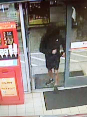 Surveillance photo of robber at Hanover Street Shell station.