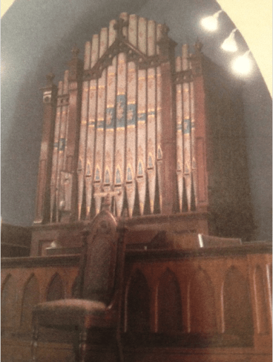 Photo of a photo of the circa 1870 George Ryder Opus 32 pipe organ at Community United Methodist Church in Byfield, MA.