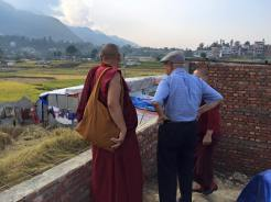 Our monk gives my father in law a tour.