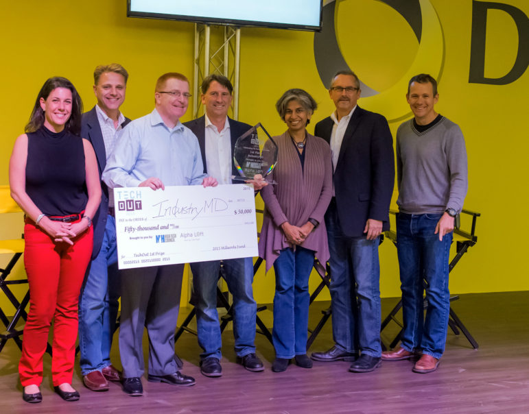 TechOut first-place winner Jim Kelly holds a check for his $50,000 prize. Also pictured from left: Michelline Dufort, Paul Mailhot, Matt Cookson, Toral Cowieson, Mark Kaplan, and Matt Rightmire.