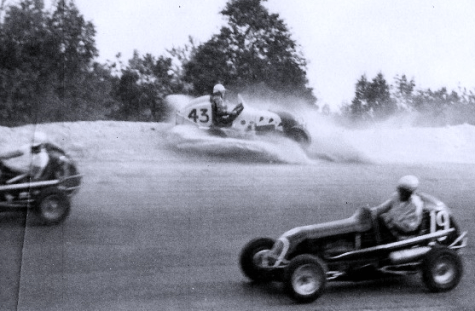 A rare Midget action-shot from New Hampshire's former Manchester Motordrome. Pictured: Art Rousseau #19, Bob Boone #3 and Pat Thibault #12.