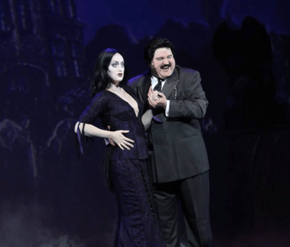 Chloe Fox as Morticia and William Hartery as Gomez, the heart of the Addams Family.