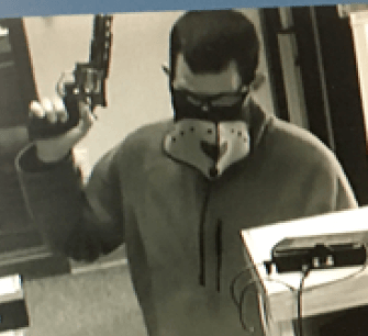 Surveillance photo of Nov. 7 Triangle Credit Union robber. Gerard Dionne was arrested Saturday in connection to that robbery.