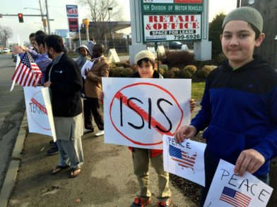 All-American brothers Hassan Khan, center, and his brother Hammad Khan, right, participated in the peace march.