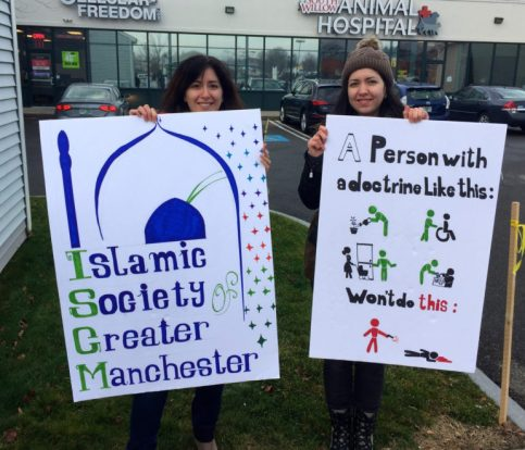 Rouba Balleh, left, and her sister Bana Balleh, worked together on signs to carry in the peace march.
