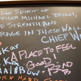 """Chalkboard message from Chief Willard: """"In the spirit of Officer Michael Briggs, may you find strength and courage in these walls."""""""