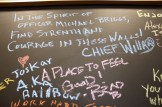 "Chalkboard message from Chief Willard: ""In the spirit of Officer Michael Briggs, may you find strength and courage in these walls."""