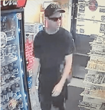 Surveillance photo of robbery suspect from Crosstown Variety.