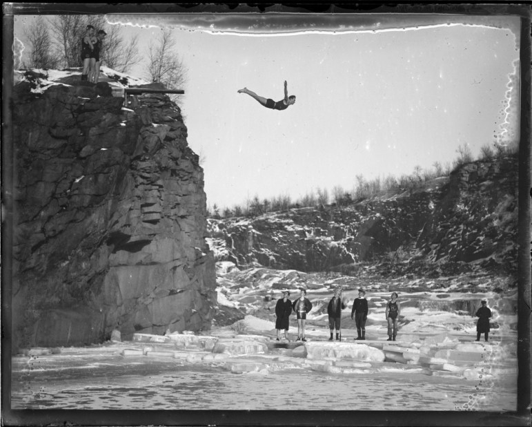 Swan dive into the icy winter wake.
