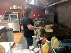 Cindy Kenney gently flips a crepe.