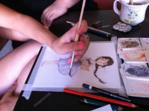 Ilaria Urbinati all'opera con l'acquerello