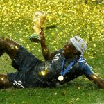 France's Benjamin Mendy celebrates with the trophy after winning the World Cup