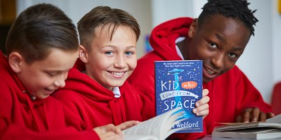 children from St John Bosco RC Primary School in Blackley with The Kid who came from Space book