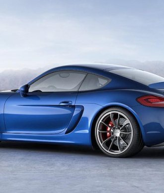 Porsche Cayman GT4 blau Heckspoiler Profil Berge