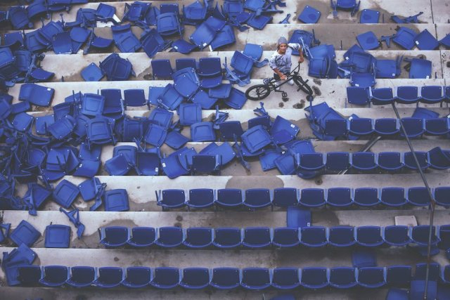 Tyler Fernengel walks through a sea of half-destroyed seats inside the abandoned Silverdome Stadium during Red Bull Revival in Pontiac, MI, USA, on 11 May, 2015. // Ryan Fudger / Red Bull Content Pool // P-20150606-00026 // Usage for editorial use only // Please go to www.redbullcontentpool.com for further information. //