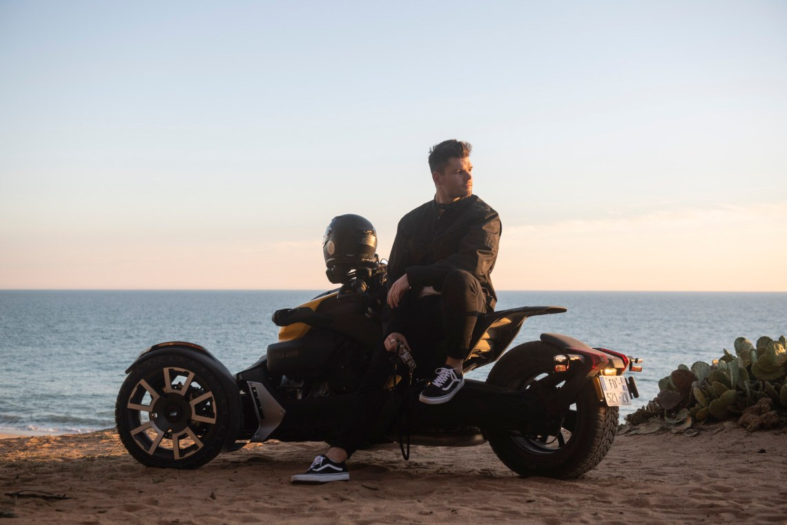 Male posing on a Can-Am Ryker Rally Edition in Algarve Portugal at sunset