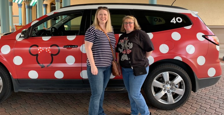 People Posing in front of a Minnie Van