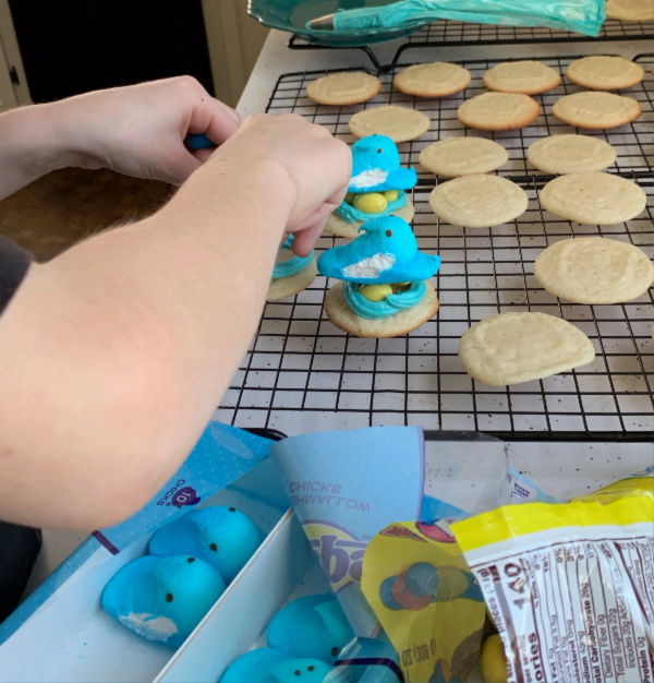 child helping with easter cookies