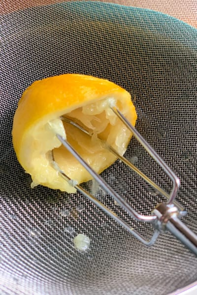Using a Hand Mixer Attachment to Juice a Lemon