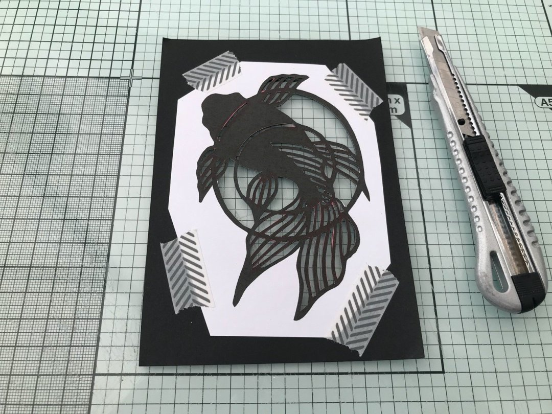 The final stages of cutting yor kirie or Japanese paper cut