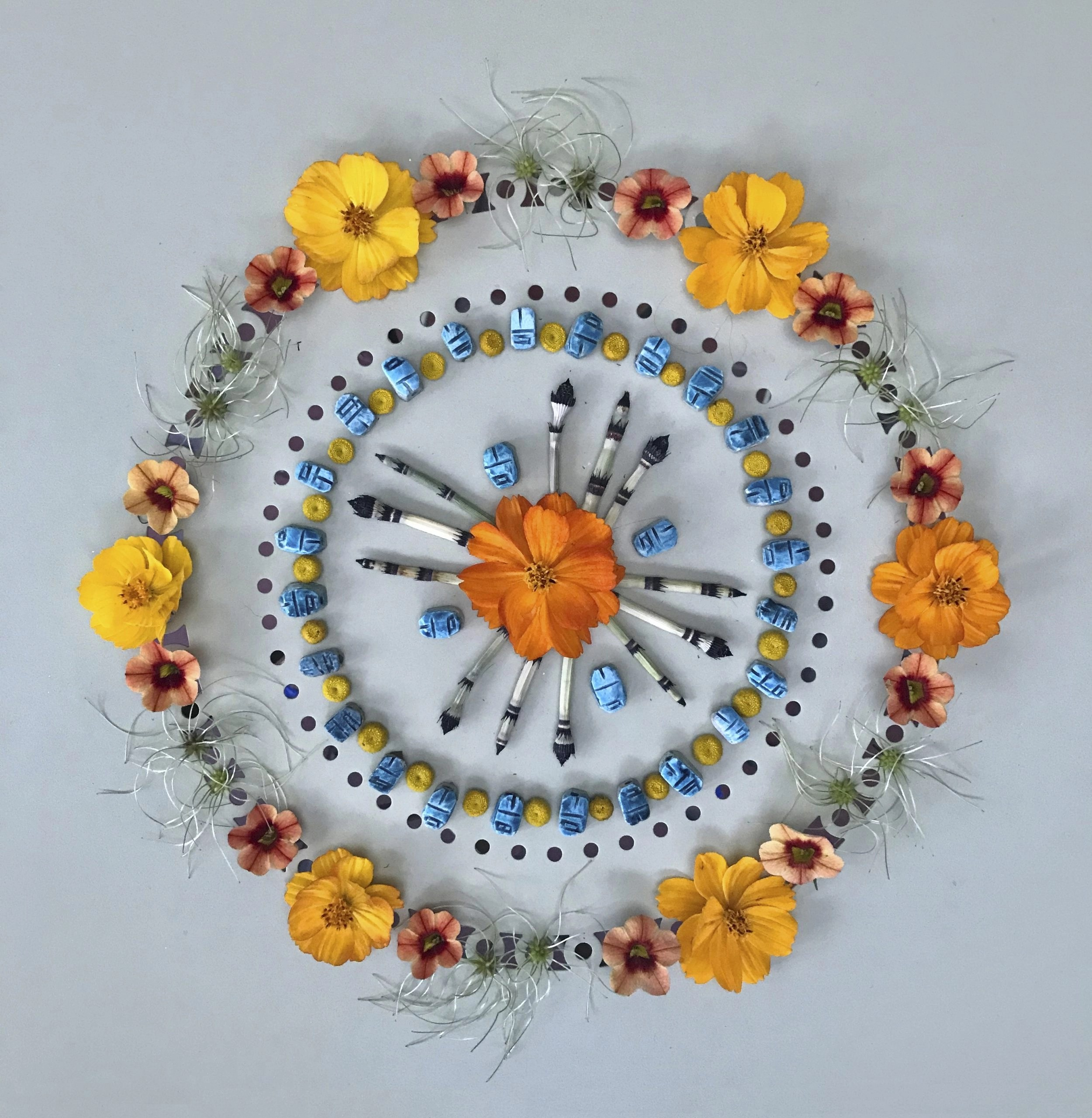 Print with orange flowers and turquoise beads