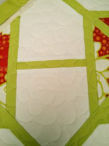 """Pop Garden """"Poppies"""", Lona chartreuse, and Bella Solids """"snow"""" on my longarm frame."""