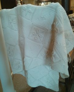 If that isn't a knit quilt with a leaf motif on it, then what the hell isn't?  Made by the young ladies of the household.