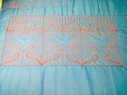 This sample, which includes rulerwork and freehand, would start in the $0.08 range due to its density and time.