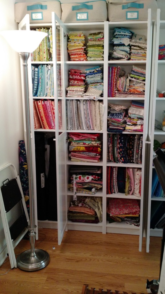 Fabric folded: smaller cuts up top, big cuts on bottom.  I have my photo stuff and collapsing design wall in the cabinet at left.