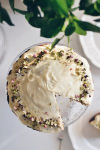 Pistachio and olive oil cake, covered in white chocolate glaze