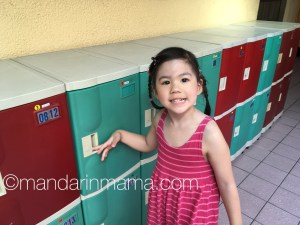 Gamera showing me her locker where she puts her outdoor shoes and her back pack.