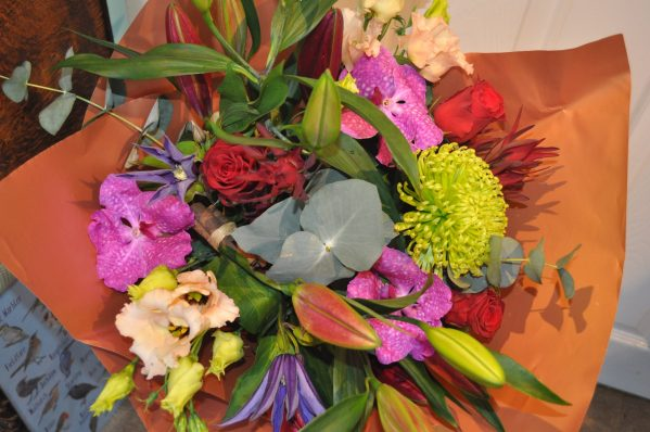 Festive Hand-tied with Orchids