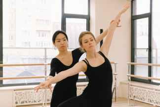 women in black tops doing ballet