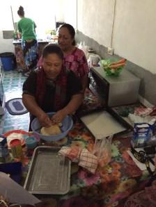Ma'ata demonstrating making the dough