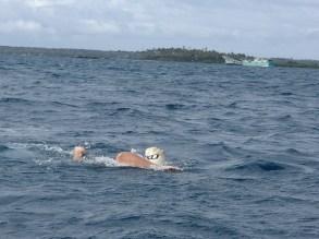 Calina on a 5km swim to Pangaimotu and back